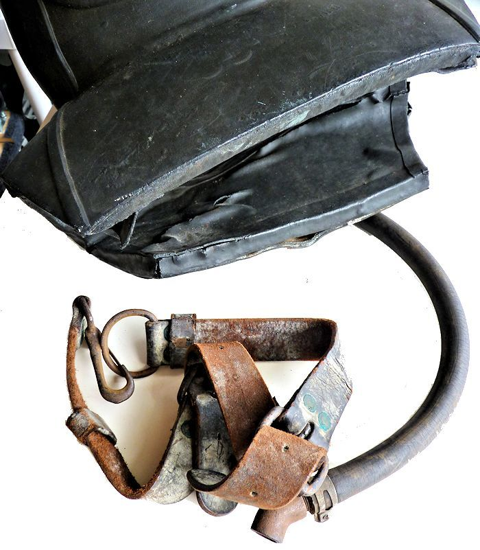 The leather belt attaches to the helmet image