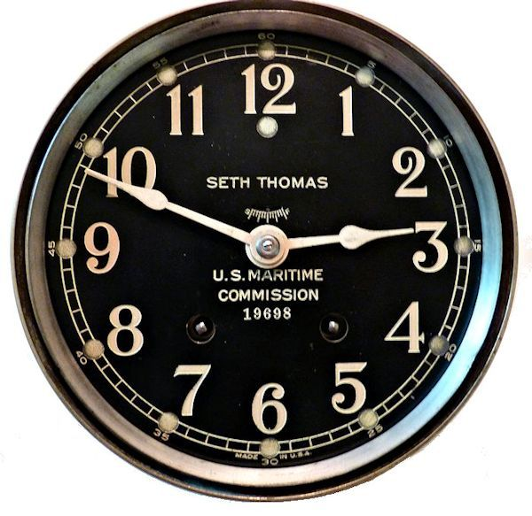 Face                                     of US Maritime Commission brass bulkhead clock image