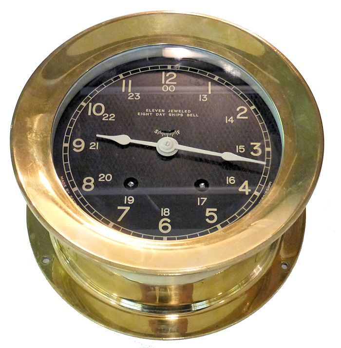Partial bottom view of string bell ships clock image