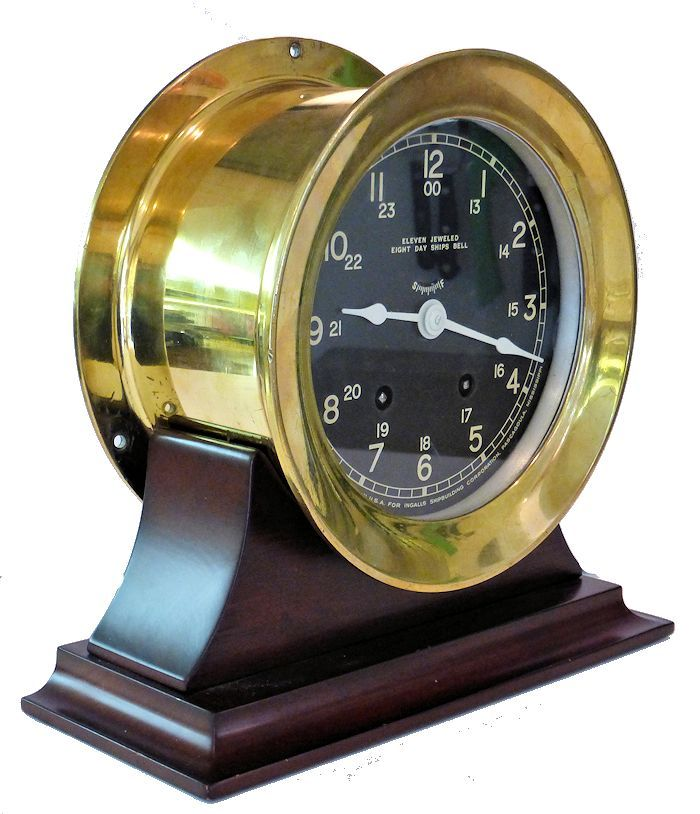 Partial fron view of 12/24 hour Seth Thomas Bells clock image