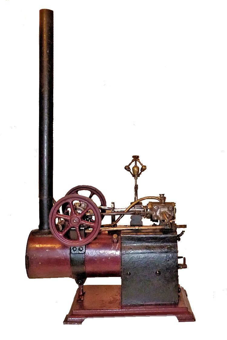 Side view of antique steam engine model image