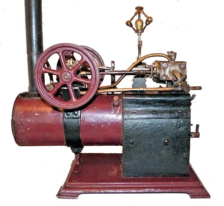 Closeup of side view of antique steam engine model image