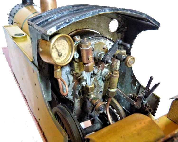 Cab end of live steam engine model showing controls image
