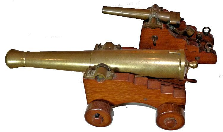 View of much larger ship's cannon with napoleon barrel image