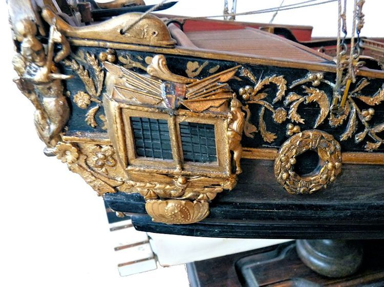 Starboard side captain's cabin with royal shield above image