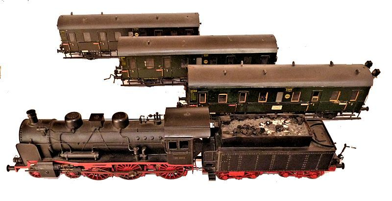 Engine, coal tender and three cars of Germain train set image