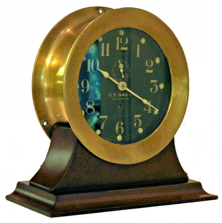3/4 front view                                     of early Seth Thomas US Navy brass bulkhead clock image