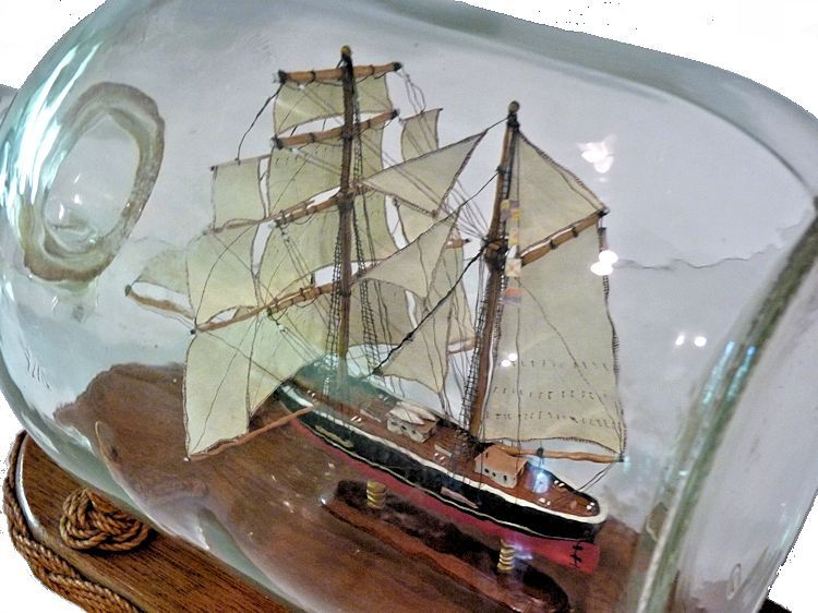 Overhead view of the sails and rigging of the model image