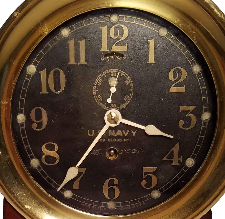 Face of early US Navy brass bulkhead clock image